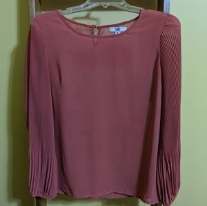 Sheer pink blouse.